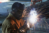 Worker welding with electric arc electrode — Stock Photo