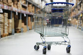 Shopping cart trolley in warehouse — Stock Photo