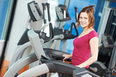 Positive woman at cardio training simulator — Stock Photo