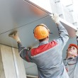 Facade workers installing metal boarding - Stock Photo