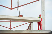 Builder worker installing concrete slab — Stock Photo