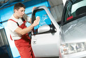 Auto service cleaner washing car — Stock Photo