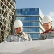 Engineers builders at construction site - Stock Photo