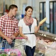 Family at food shopping in supermarket — Stock Photo #13981051