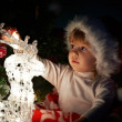 Little girl with gifts at Christmas or new year — Stockfoto