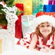 Little girl with gifts at Christmas or new year — Stock Photo #14040946