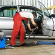 Постер, плакат: Cleaning service of automobile vacuum clean
