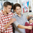 Royalty-Free Stock Photo: Young family at clothes shopping store