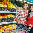 Family at food shopping in supermarket - Stock Photo