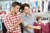 Young family at clothes shopping store — Stock Photo