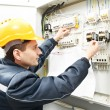Electrician with drawing at power line box — Stock Photo #14610425