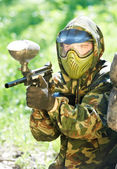 Paintball player holding fire — Stock Photo
