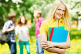 Smiling student girl outdoors — Stock Photo