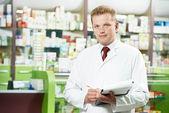 Pharmacy chemist man in drugstore — Stock Photo