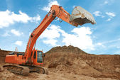 Track-type loader excavator at work — Stock Photo