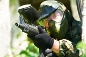 Paintball player in summer. Shallow DOF — Stock Photo