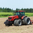 Stock Photo: Ploughing tractor at field cultivation work