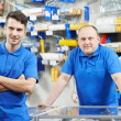 Sellers team at home improvement store - Stock Photo