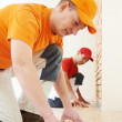 Parquet workers at flooring work — Stockfoto