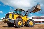 Wheel loader excavator at work — Stock Photo