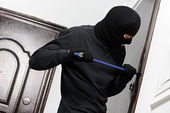 Thief burglar at house breaking — Stock Photo