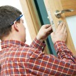 Stock Photo: Carpenter at door lock installation