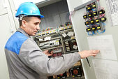 Electrician working at power line box — Stock Photo