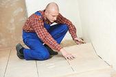 Tiler at home floor tiling renovation work — Stock Photo