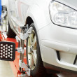 Stock Photo: Car at wheel alignment diagnostic tester