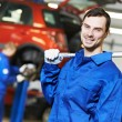 Repairman auto mechanic at work - Photo