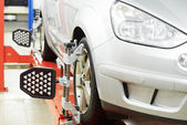 Car at wheel alignment diagnostic tester — Stock Photo