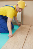 Cork worker at flooring work — Stock Photo
