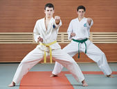 Two man at taekwondo exercises — Stock Photo