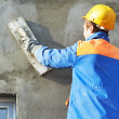 Facade builder plasterer at work — Stock Photo #18915061