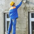Facade builder plasterer at work - Stock Photo