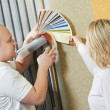 Seller and buyer matching paint color - Stockfoto