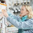 Woman shopping paint at hardware store — Stock Photo