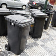 City garbage trash cans containers - Stock Photo