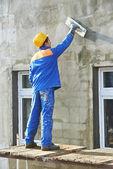Facade builder plasterer at work — Stock Photo