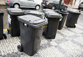 City garbage trash cans containers — Stock Photo