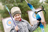 Child Archer with bow and arrows — Stock Photo