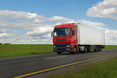 Red lorry truck with trailer — Stock Photo