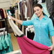 Stock Photo: Young womat apparel clothes shopping