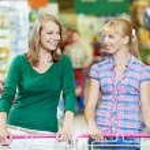 Two women at supermarket shopping — Stock Photo