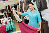 Young woman at apparel clothes shopping — Stock Photo