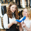 Two woman choosing shoes in footwear store — Foto de Stock