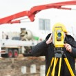 Surveyor works with theodolite — Stock Photo