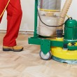 Parquet Floor maintenance by grinding machine - Stock Photo