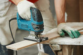 Cutting parquet board with jigsaw — Stock Photo