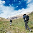 Stock Photo: Two tourist hiking in indimountains
